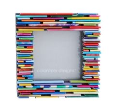One of Colorstory Designs' colorful picture frames made from recycled mags. Also love the ones in blues.