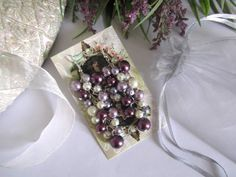 #handmade #jewelry #cluster #earrings A stylish pair of wedding earrings featuring a dangling cluster of pearls in ivory, lilac, lavender and plum.