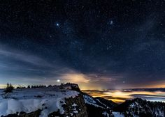 'Lights at Night' - photo by Roland Bill Moser, via naturephotographers;  A photo of the night sky from the Jura Mountains in Switzerland, with city lights shimmering through a layer of fog.     http://www.naturephotographers.net/imagecritique/ic.cgi?a=vp&pr=213454&CGISESSID=6edf494c2e2d62a3ed171e44c7d9e8b4&u=20588