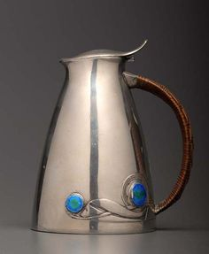 Archibald Knox for Liberty & Co: an Art Nouveau pewter and enamel lidded jug #ukauctioneers