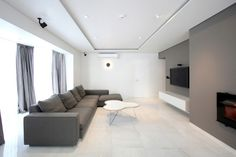 Minimalist Interior Design With Fashionable Style Reflect The Beauty of Simplicity : Living Room Design Marble Floor White Grey Wall Simple Sofa Cushion Floating Lcd Tv Fireplace Curtain And Ceiling Lighting