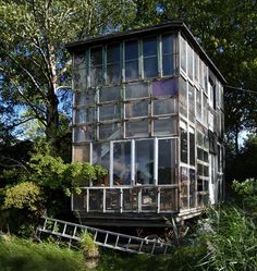 "Glass house in Freetown Christiania, Copenhagen, exemplifying modern ""architecture without architects""."