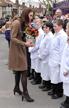 Kate Middleton Photos Photos - Catherine, Duchess of of Cambridge wears an Orla Kiely 'Birdie' dress as she pays a visit to Rose Hill Primary School, and Oxford Spires Academy School. - Kate Middleton Visits Rose Hill School 7