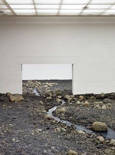 Olafur Eliasson installs gigantic riverbed in Danish museum