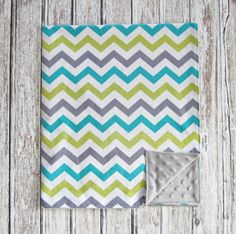 Hey, I found this really awesome Etsy listing at https://www.etsy.com/listing/182788955/chevron-baby-blanket-aqua-gray-white-and
