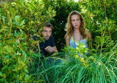 Angie (Britt Robertson, right) helps Barbie (Mike Vogel, left) find and protect Julia from Big Jim