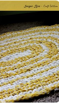 here's how to make one of those rag rugs, just using old sheets - love this!