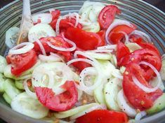 Marinated Cucumbers, Onions, and Tomatoes  3 medium cucumbers, peeled and sliced 1/4 inch thick 1 medium onion, sliced and separated into rings  3 medium tomatoes, cut into wedges 1/2 cup vinegar 1/4 cup sugar 1 cup water 2 teaspoons salt 1 teaspoon fresh coarse ground black pepper 1/4 cup oil  Combine ingredients in a large bowl and mix well. Refrigerate at least 2 hours before serving.