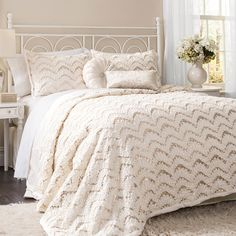 Highlighted by dramatic chevron-inspired design and shimmering ribbon details, this elegant comforter set outfits your bed in luxe style.  ...