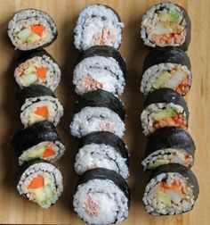 Homemade Sushi (Philly roll) - Basic sushi recipe. To make sushi with rice on outside, flip nori before filling. Use your imagination to create different roles. Philly Roll: Salmon, cream cheese, cucumber, green onion. Spicy Crab Roll: Imitation crab mixed with spicy mayo,cucumber, jalapeño....