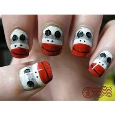 Sock Monkey Nails. Would look lovely on toes while hands could be painted in the same solid red color. Conservative and kinky.