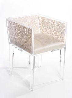 """Design: Floral Lace Chair  Materials: Acrylic and Crochet Lace    Pitch: """"The Floral Lace Chair is a combination of function and fashion, featuring a sleek acrylic frame encasing delicate crochet lace within the back and sides. The seat is upholstered in silk. The inspiration for this piece came out of the desire to make a chair that was as beautiful as a dress and as irresistible to women as a pair of shoes!"""""""