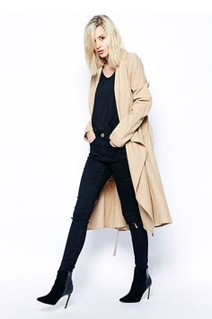 Be A Sellout: 20 Fall Buys To Watch Out For #refinery29  http://www.refinery29.com/shopping-list#slide1  The perfect wool trench to go with everything in your closet.