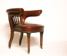 REGENCY LIBRARY CHAIR OR COCK FIGHTING CHAIR IN BURGUNDY LEATHER & CASTORS