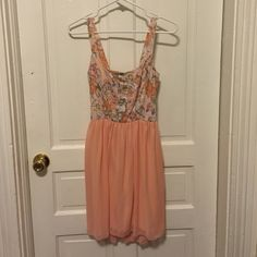 Peach Summer Dress Adorable peach dress! Floral print on top and chiffon, lined bottom! Great for wedding season! Perfect condition! Charlotte Russe Dresses Mini