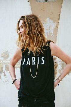 noticed: muscle tees and delicate jewelry. model erin wasson is wearing a black madewell linen paris stencil muscle tee, gildpath necklace, gildpath bracelet, glider bangle and leather id bracelet.