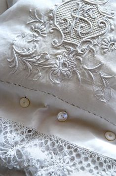 White embroidery on white linen. Pillow cases close with tint Pearl buttons. - Pillows Case - Ideas of Pillows Case - White embroidery on white linen. Pillow cases close with tint Pearl buttons. Antique Lace, Vintage Lace, Bordados E Cia, Fru Fru, Chenille, Linens And Lace, Fine Linens, White Embroidery, Embroidered Lace