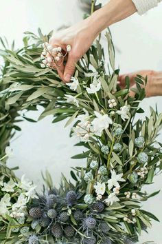 Beautiful whites and blues in this DIY olive branch holiday wreath.