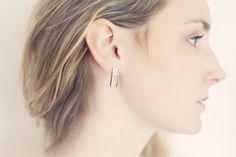 The Skin Collection is a design study on the combination of different materials and tactile sensations. The result is an harmonious balance of the best Italian leathers and Nordic geometric shapes.The Hut earrings are an elegant everyday jewel combining sterling silver with Italian champagne coloured leather.