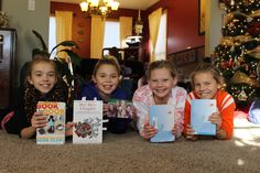 Pictured are four of the five fifth-graders who, with the help of their mothers, formed a book group two years ago to meet friends from other schools and talk about things going on in their lives. From left are Evan Bay Brakke, from Kate Mitchell Elementary; Jenna Helfer, from Sawyer Elementary; Ava Anderson, from Fellows Elementary; and Ainsley Jurgens, from Edwards Elementary. Not pictured is Sunneva Sigurdsdottir, from Meeker Elementary. Photo by Melissa Erickson/Ames Tribune