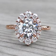 Vintage inspired Hearts & Arrows moissanite halo ring + conflict-free diamonds in rose gold