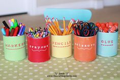 Store school and art supplies in these adorable repainted hot chocolate tins with stenciled-on labels. Get the tutorial at The Crafty Chicks.   - CountryLiving.com