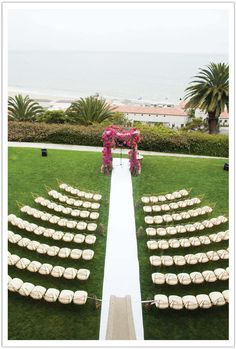 clean white aisle, ocean backdrop, vibrant bougainvillea chuppah - perfection! Design by Alchemy Fine Events, Florals by Krista Jon