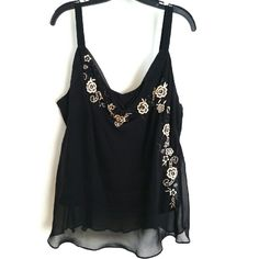 "Lane Bryant Black Chiffon Embroidered Tank Size 20 This Lane Bryant Black Chiffon Embroidered Tank is a Size 20 in good used condition. Beautiful top made of layered chiffon with pretty flowers embroidered on the front. Bust measures 24"" across laying flat, measured from pit to pit, so 48"" around. No stretch. Aprox. 30"" long. ::: Bundle 3+ items from my closet and save 30% off when you use the app's Bundle feature! ::: No trades. Lane Bryant Tops"