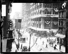 1908. View of 4th Street in Cincinnati, Ohio, with buildings decorated with banners, swags and United States flags. Some of the flags read: Taft for president