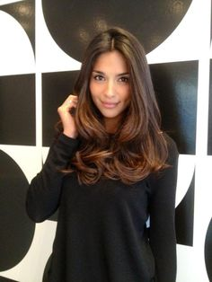 Brunette hair styled in soft waves