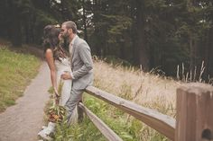 We love this shot of the bride and groom against a worn wooden fence post. Perfect for a rustic wedding!