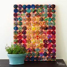 A colorful and creative piece of artwork makes the perfect unique Christmas gift for anyone in your life. Fabric yo-yos assembled in straight rows show off the beautiful patterns. Sew yo-yos together, then attach them to the edge of the frame with a staple gun. To speed things up, skip the sewing and use a hot-glue gun to secure the yo-yos in place.