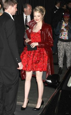 Emma Stone wearing Lanvin Fall 2012 Clutch, Lanvin Pre-Fall 2012 Trench Coat, Lanvin Specially Made Cherry Red Square Neck Mini Cocktail Dress with a Full Skirt and Floral Appliques and Lanvin Winter 2011 Metal Tip Pump.