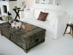 Only thing I like in this room is the distressed chest being used for a coffee table. Must have.