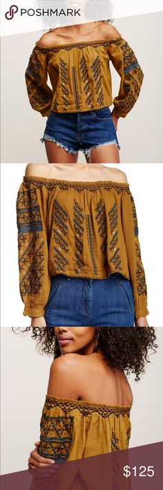 Free People All I Need Top ⭐️NWT⭐️SMOKE/PET FREE HOME⭐️ SOLD OUT STYLE. Super soft and lightweight. Approx 21 inches from shoulder to hem. Embroidered detail. Elasticized ruched top button cuffs. 52% cotton. 48% viscose. Hand wash. Color is called moss. Color is an orange/greenish/brown. Free People Tops Tees - Long Sleeve