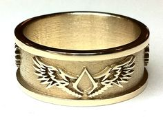 14ct yellow gold wedding ring with clients own choice of winged emblem - Atelier Bespoke Fine Jewellery, Nottinghamshire