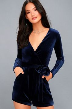 Lulus Exclusive! Let your your heart lead you to the dance floor in the Romantic Moves Navy Blue Velvet Long Sleeve Romper! Soft and stretchy velvet shapes a darted, surplice bodice framed by fitted long sleeves. Tying sash accents the waist above relaxed shorts with rounded, side seam pockets. Hidden back zipper/clasp.