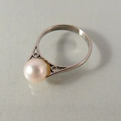 This is a 8 mm solitaire pearl with excellent luster and thick nacre.  The pearl is perfect, showing no blemish and has a creamy white hue. It is set on an intricate #18K so... #18k #gold #stamped #jewelry #estate #teamlove ➡️ http://jto.li/c9r2K