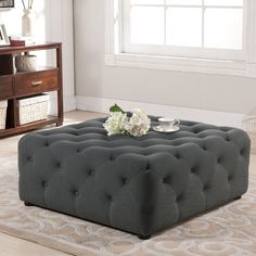 Practical as both an ottoman and a coffee table, this two-for-one living room accent piece was love at first sight for us. Our Teague Tufted Ottoman is made with eucalyptus wood, firm foam padding, and grey linen upholstery.