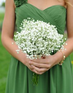 green bridesmaid dress and white bouquet