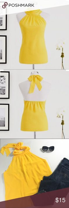 "Eva Mendes Halter Blouse Softly shirred embellishment infuses Eva's halter blouse with feminine flair; a lemon color adds a vibrant, Mediterranean-inspired accent. From the exclusive Eva Mendes Collection. 20"" armpit to armpit, 26"" neck to hem. A39 New York & Company Tops Blouses"