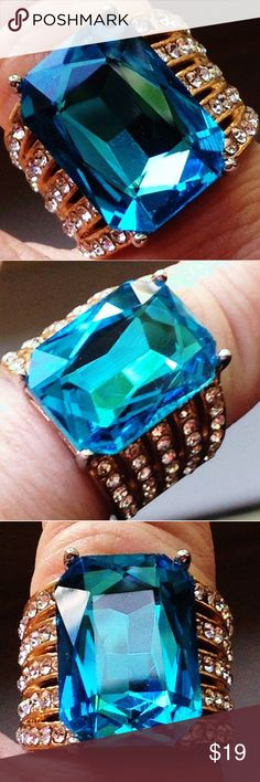 🔥NWT! Aqua Blue Austrian Crystal  + Crystal Ring 🔥BRAND NEW. TAG ON. STAINLESS STEEL. Size 6 ladies - COMFORT BAND featured on this STATEMENT RING- AQUA BLUE GENUINE AUSTRIAN CRYSTAL LUXURY STATEMENT PAVE AUSTRIAN CRYSTAL Adorn Accent Gemstones. Smooth. Well made. Bought from USA Jewelry Store. 5 rows of Austrian Crystals + 1 center STUNNING AQUA BLUE AUSTRIAN CRYSTAL ( 18x13 mm fancy faceted octoganol) featuring 14kt Gold overlay , clear white (with firey rainbow shimmers) on both…