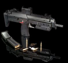 The HK Read the specs on this sub-machine gun, it's fascinating! Very cool looking piece of kit. Weapons Guns, Guns And Ammo, Revolver, Submachine Gun, Fire Powers, Home Defense, Cool Guns, Assault Rifle, Rifles