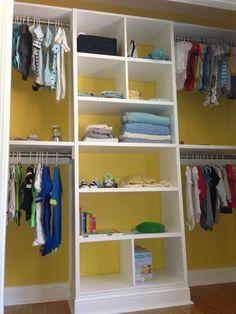 Yellow nursery closet builtin shelving