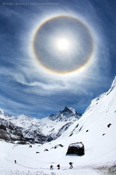 """Halo or Ordinary Wonder"" - photo by Anton Jankovoy, via 500px;  seen at the Annapurna Base Camp in Nepal"