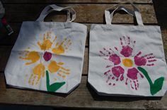 Mother's Day totes and maybe use feet outlines as stem...http://paintcutpaste.com/handprint-flower-tote-bag/