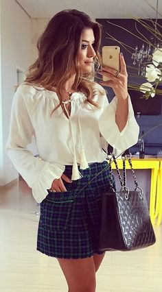 Top| Blouse| White| V neck| Plunging neckline| Cleavage| Long sleeve| Flared| Tucked in| Skirt| Green| Mini| Short| Leg| Plaid| Patterned| Checkered| Multicolored| Bag| Purse| Tote| Handbag| Black| Leather| Snake skin| Snake print| Ring| Gold| Necklace| Spring| Fall| Autumn| P8114