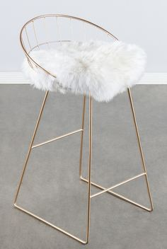 "Materials: Metal, genuine sheepksin Measurements : 33""h x19.5""w x21""d pounds, 10 pounds Seat height: 26"" Colors: gold, white"