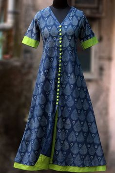 Buy Maati Crafts Blue Cotton Printed Front Cut Anarkali Kurti online in India at best price. a long kurta with indigo & white print, short sleeves and lime green steel buttons! the main fabric Salwar Designs, Kurta Designs Women, Kurti Designs Party Wear, Blouse Designs, Dress Designs, Salwar Pattern, Kurta Patterns, Dress Patterns, Saris
