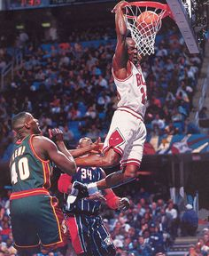 "Michael Jordan in the Air Jordan XII ""Playoffs"" dunking on Hakeem and Kemp in the 1997 NBA All Star Game"